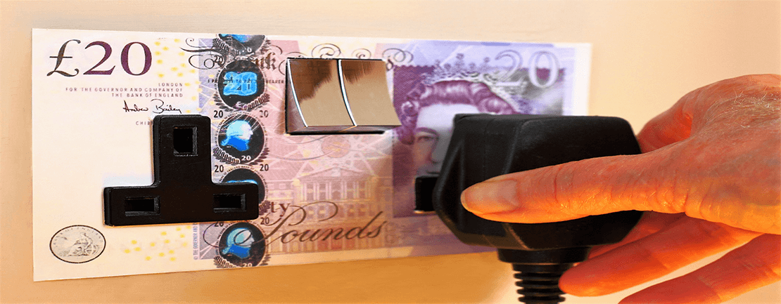 Electrical socket covered with £20 note: energy expenses