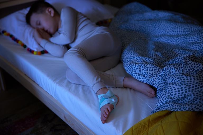 Owlet Smart Sock on older child photo