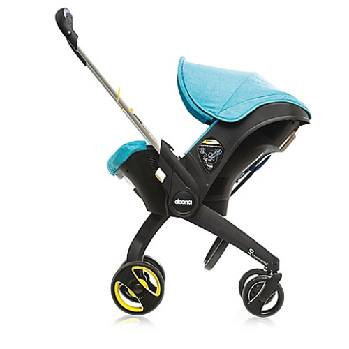 Doona™ Infant Car Seat/Stroller with Latch Base in Turquoise - $499.99