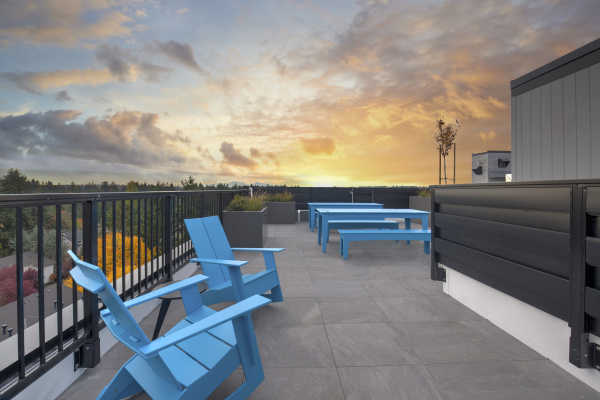 Rooftop deck with sunset.