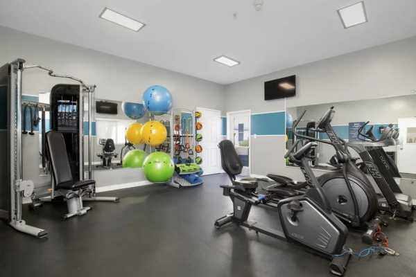 Community workout room with exercise bikes and other equipment