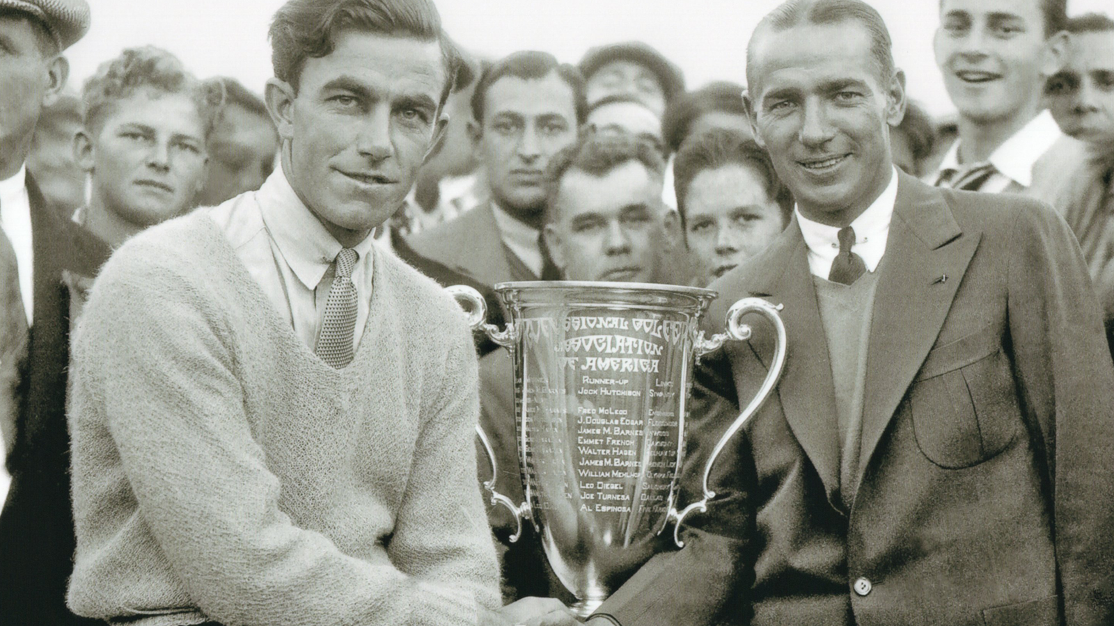 Johnny Farrell and 1929 PGA Champion Leo Diegel posing for the first time with the new PGA Championship trophy.