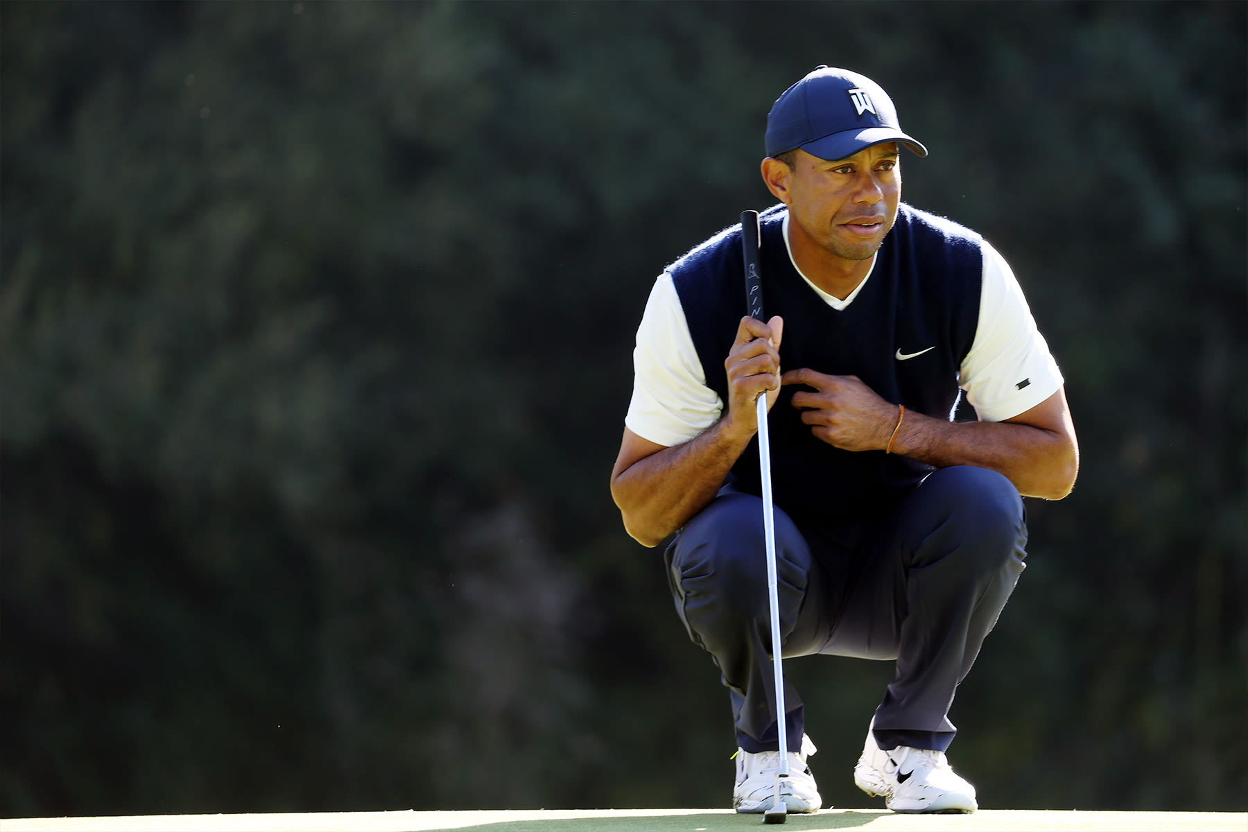 Tiger Woods of the United States lines up a putt on the 12th green during the third round of the Genesis Invitational at Riviera Country Club on February 15, 2020 in Pacific Palisades, California.