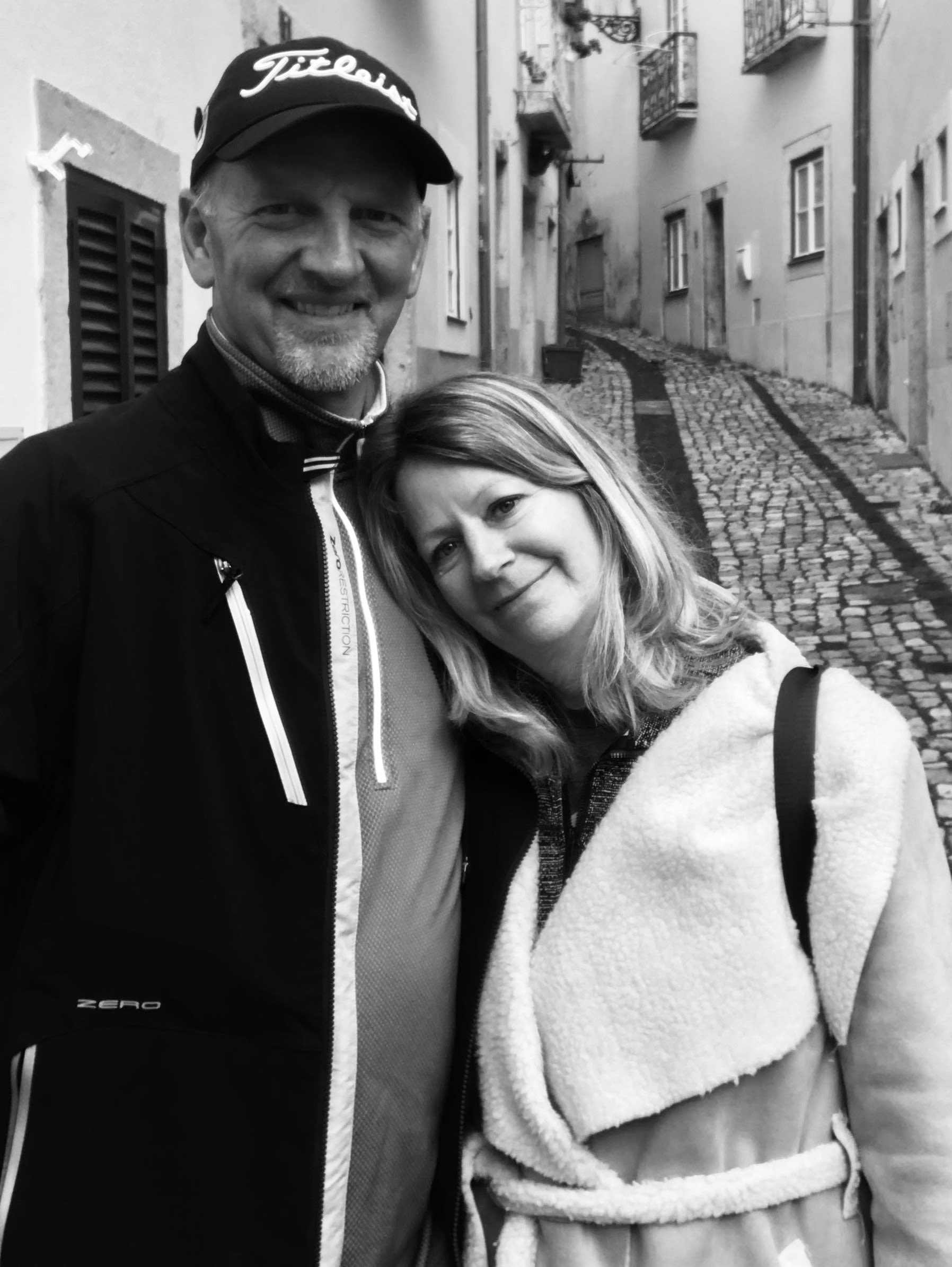 Doug and Karla Rohrbaugh pose for a photo in street in Lisbon, Portugal on Feb. 13, two days before arriving back in the United States.