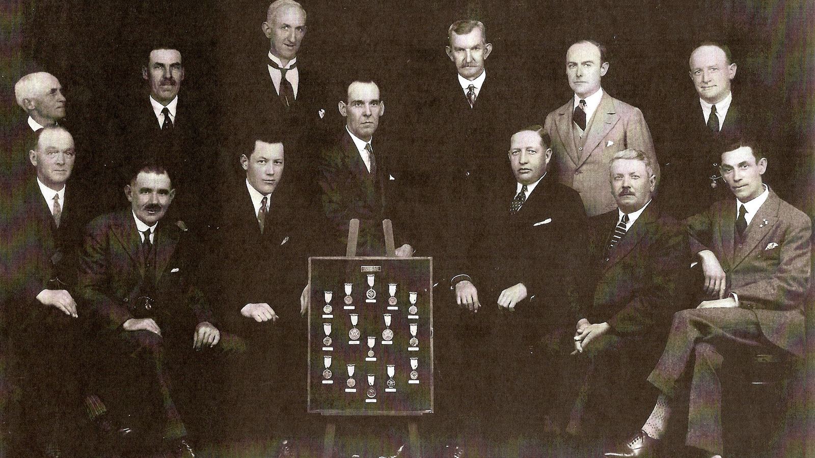 Macdonald Smith, seated to the right of the championship medals board, presenting the bequeathed collection of his recently deceased brother Alex, to the club of their childhood, Carnoustie Golf Club.