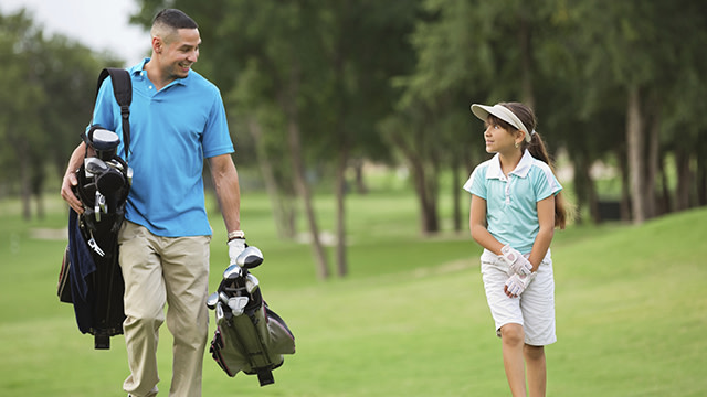 Father and daughter on course