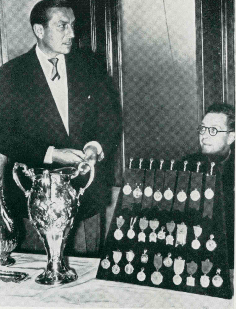 Family friend Henry Cotton presenting Mcdonald Smith's championship medals to Carnoustie Golf Club, 1950.