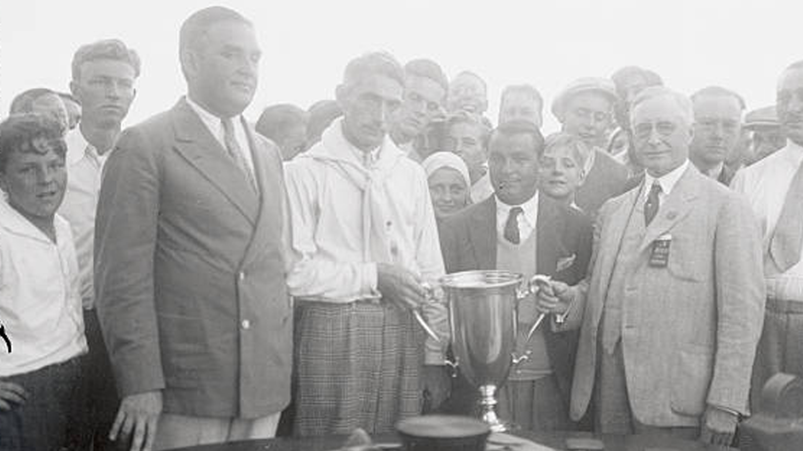 Left to right: 1930 Champion Tommy Armour, runner-up Gene Sarazen and PGA Business Manager A.W. Gates with the PGA Championship trophy.
