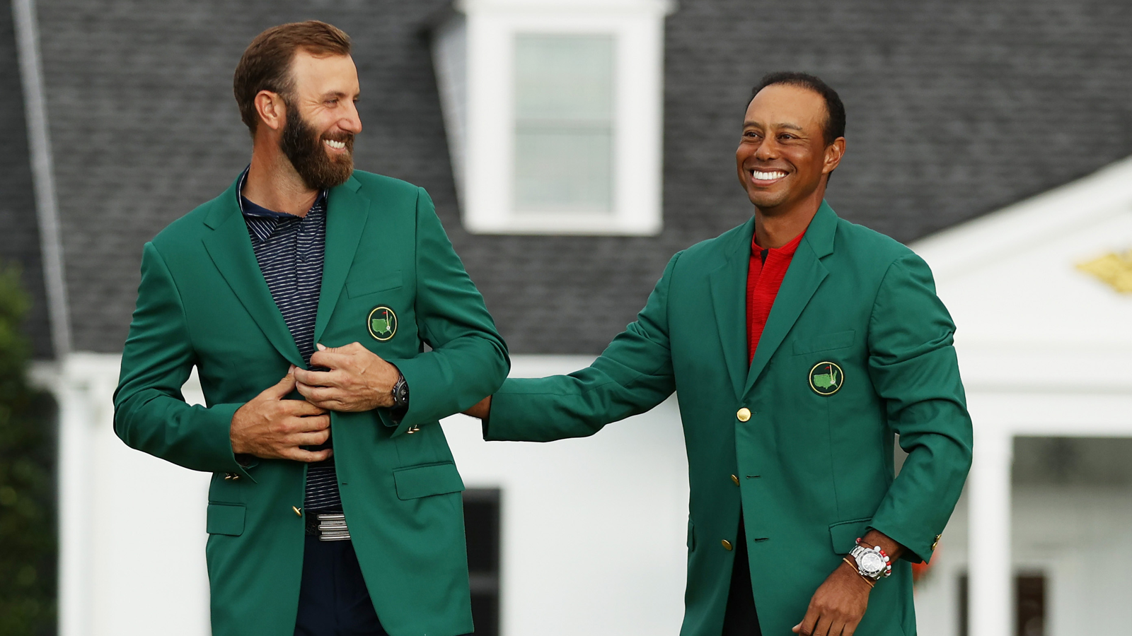 Tiger woods presents Dustin Johnson with the green jacket at the 84th Masters.  (Photo by Patrick Smith/Getty Images)