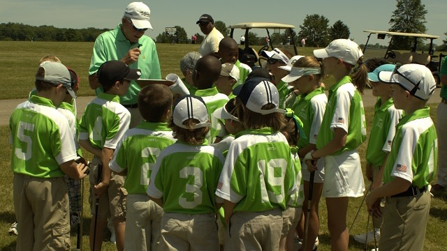 Junior golf team and coach