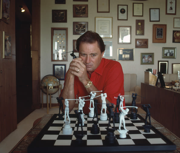 Raymond Floyd contemplating his next move at a chess set with golfers as chess pieces at his home, circa 1989. (Photo by Leonard Kamsler/Popperfoto via Getty Images)
