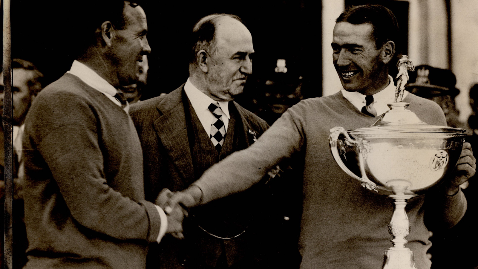 Left to right: Al Espinosa (runner-up), Broenig (Baltimore Mayor) and Leo Diegel (1928 PGA Champion) holding the stand-in Maryland Open Trophy.