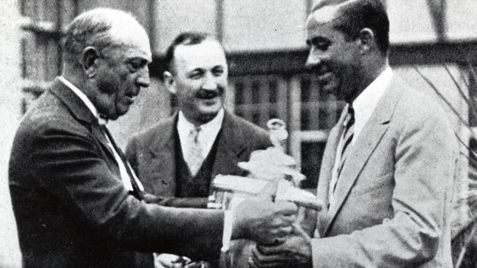 September 26, 1925 - Walter Hagen receives back the Wanamaker Trophy from Olympia Fields President Charles Smalley as Vice President Albert M. Saxe looks on.