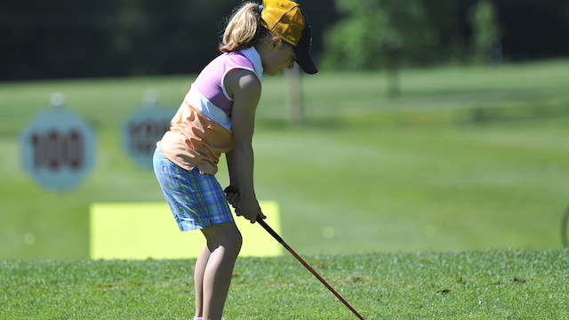 Girl setting up to tee off