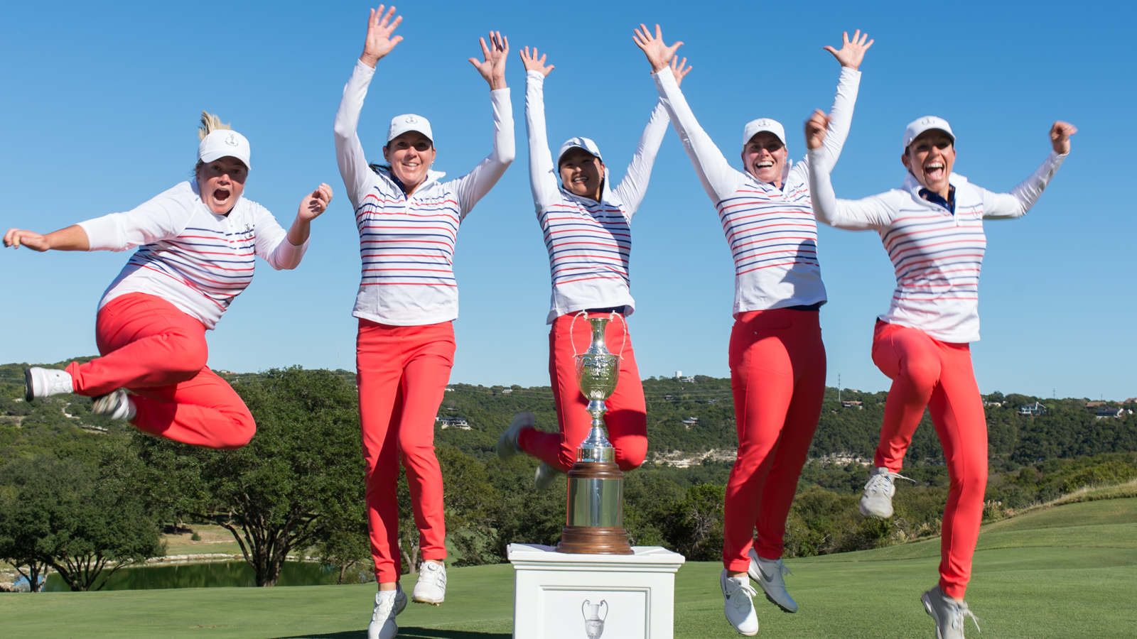 Brittany Kelly (far left) celebrates the Women's PGA Cup victory with her teammates.