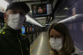 Doug and Karla Rohrbaugh wearing surgical masks in a train station in Guangzhou, China - Jan. 23, as they left for Thailand