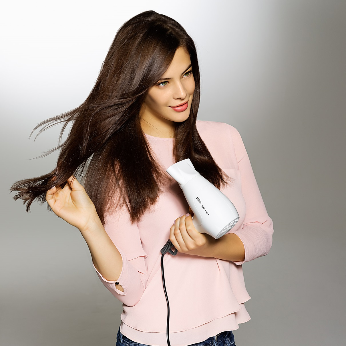 Satin Hair 1 PowerPerfection dryer HD180 in use