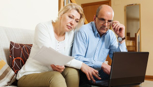 Couple looking at their will online