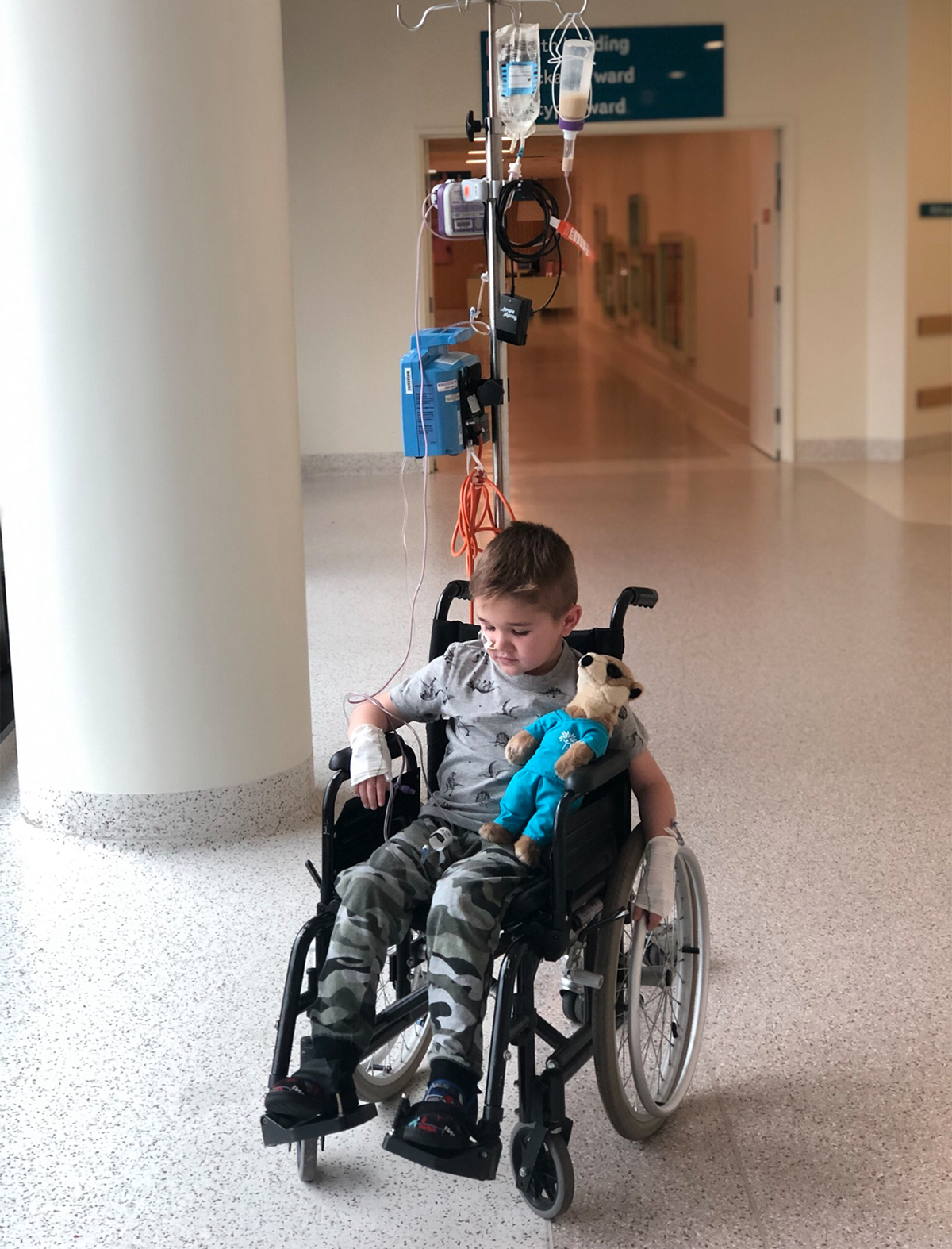 Chayse in wheelchair looking down