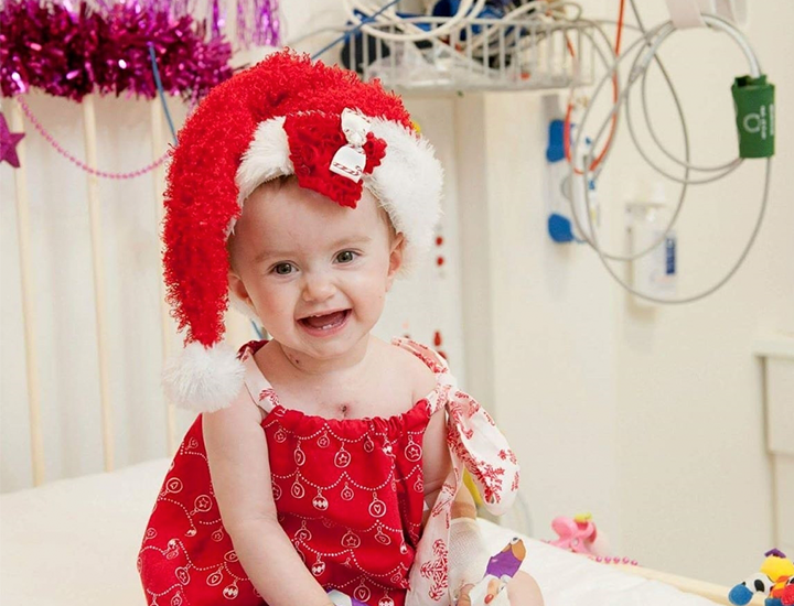 Abigail as a baby in hospital during Christmas