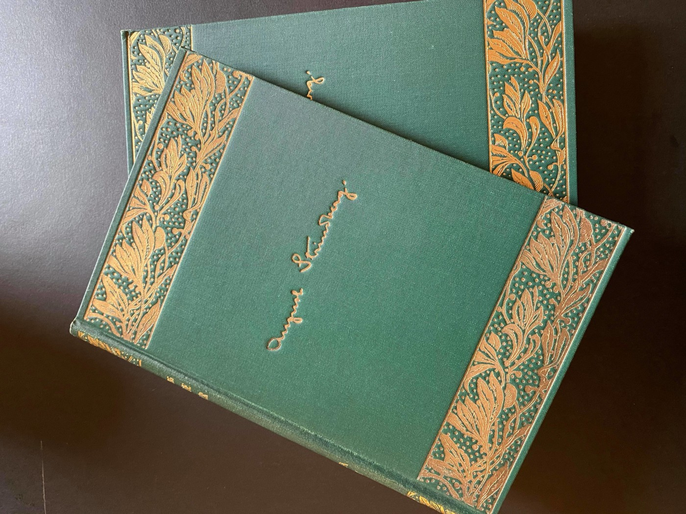 Green book with golden text