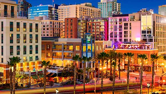 A colorful snapshot of San Diego, full of buildings and palm trees