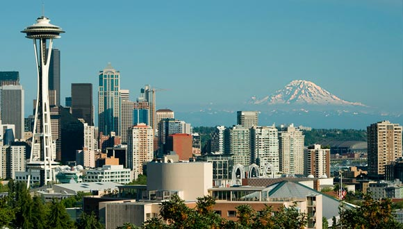 The Seattle skyline with Space Needle on left and Mt. Rainier in the background