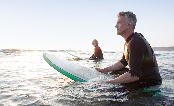 Two people on surfboards