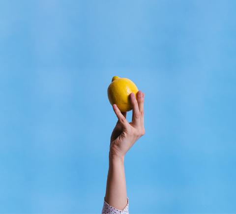 Holding a Lemon