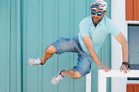 Man jumping over guard rail