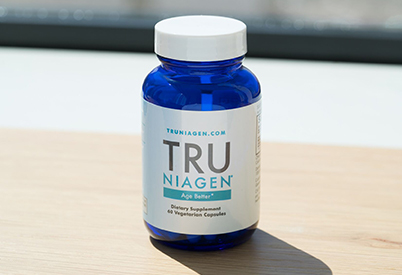 bottle of Tru Niagen on a flat wood surface