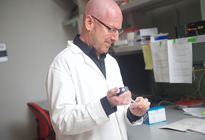 Dr. Charles Brenner in the lab