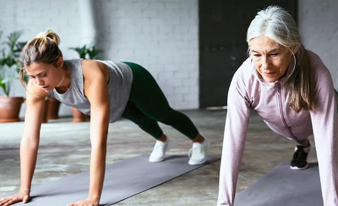 Two women doing push ups