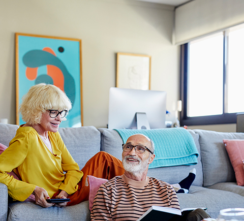 An image of two parents sitting in their living room.