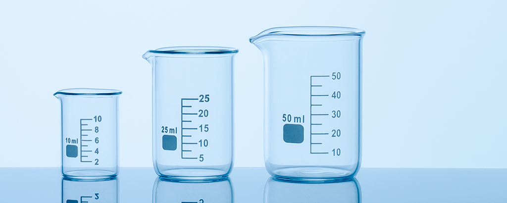 Three differently-sized beakers on a table
