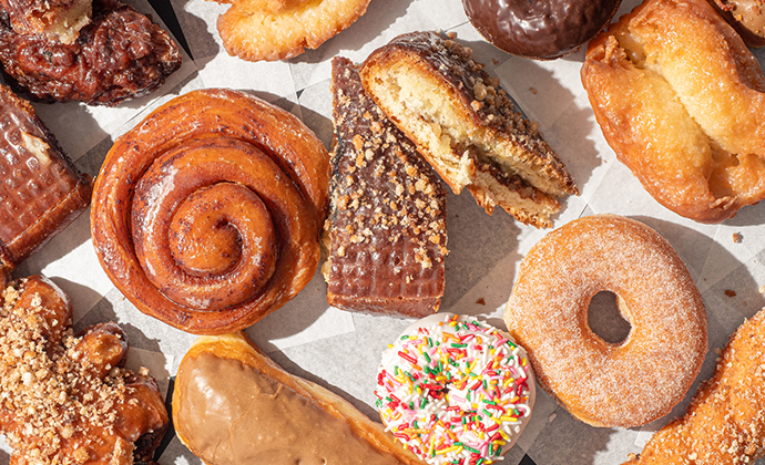 An image of sweets, donuts, and other junk food.