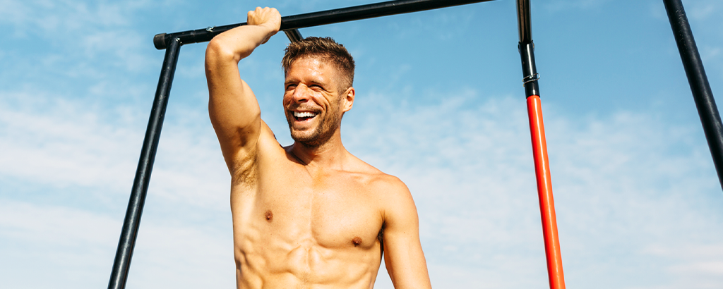 fit man doing pull ups