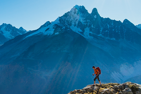 mountaineer summiting a peak