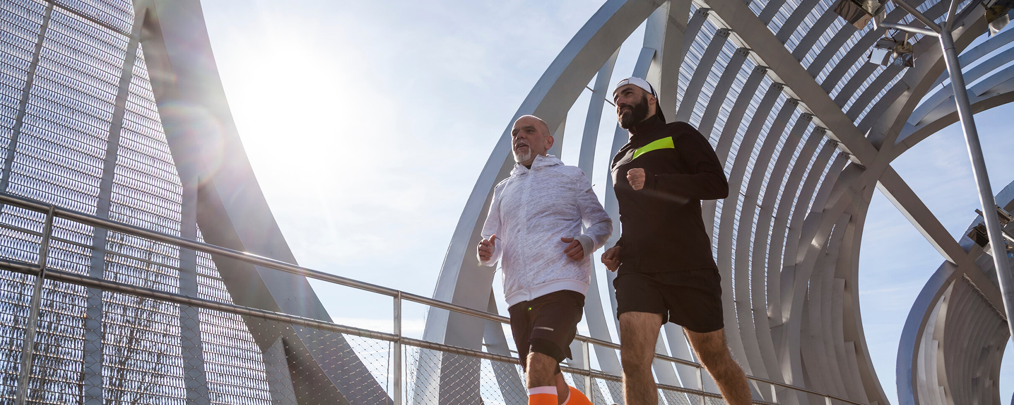 An image of two friends jogging.