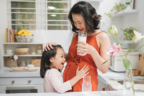 mom holding a glass of milk