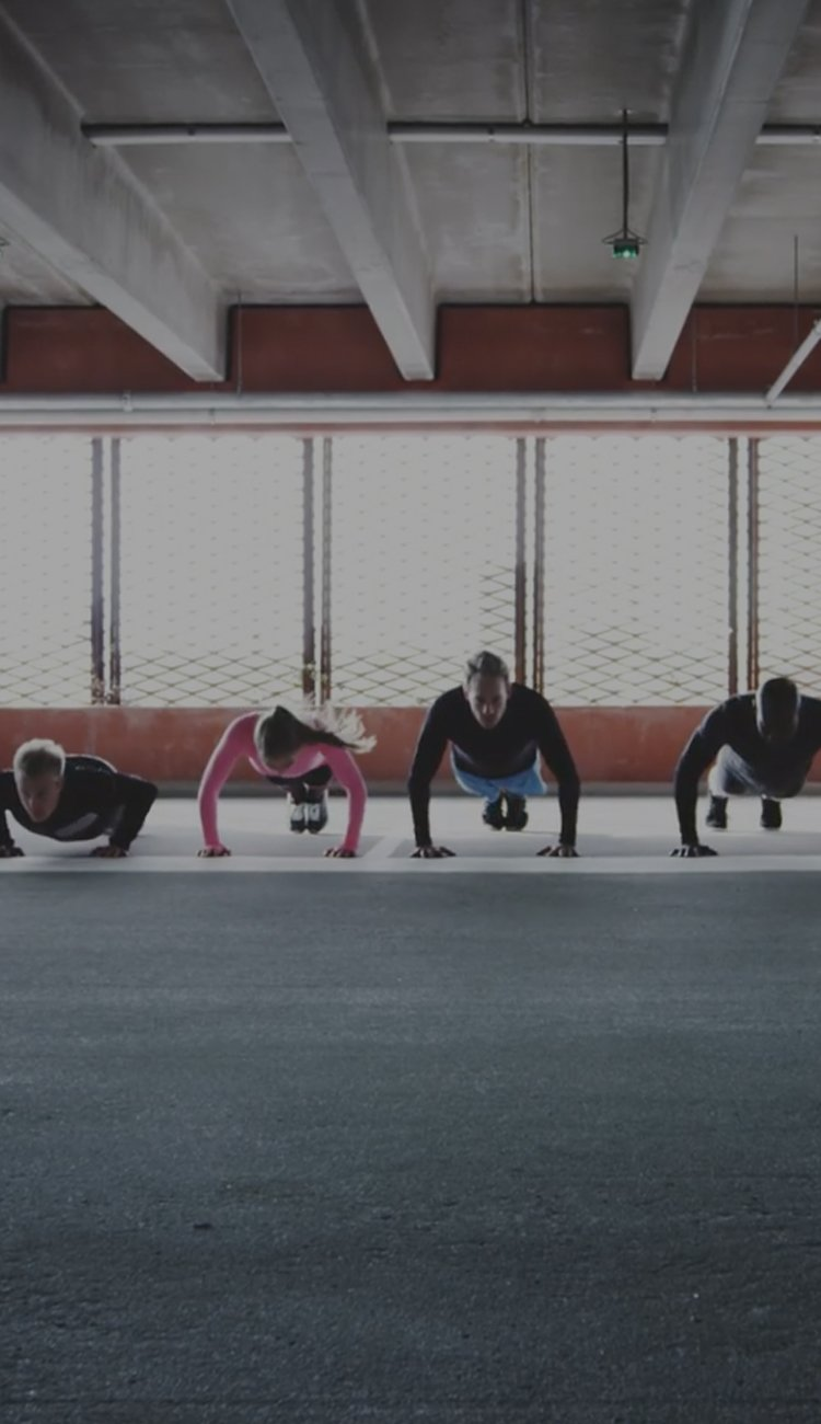 Image of several people doing push-ups.