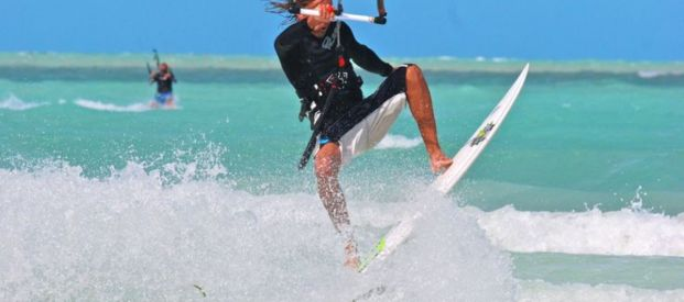 Kiteboarder doing jumps.