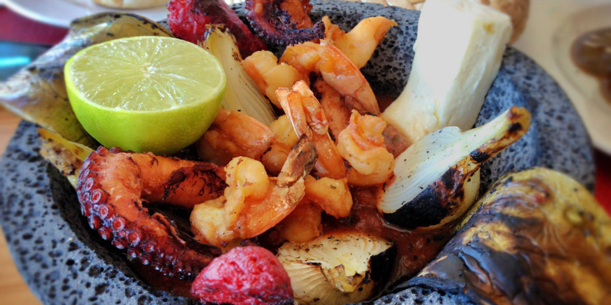 A bowl of Holbox seafood and meat, we have the complete guide of where to eat and drink