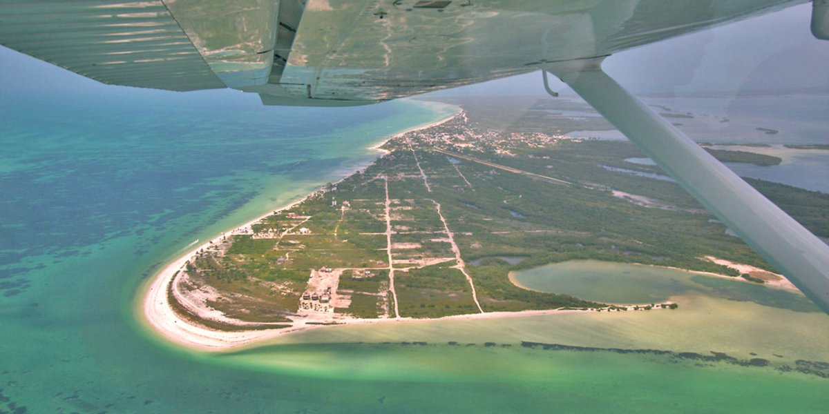 A stunning starboard view of the plane wing and Punta Cocos beach on Isla Holbox. Photo Credit Šarūnas Burdulis