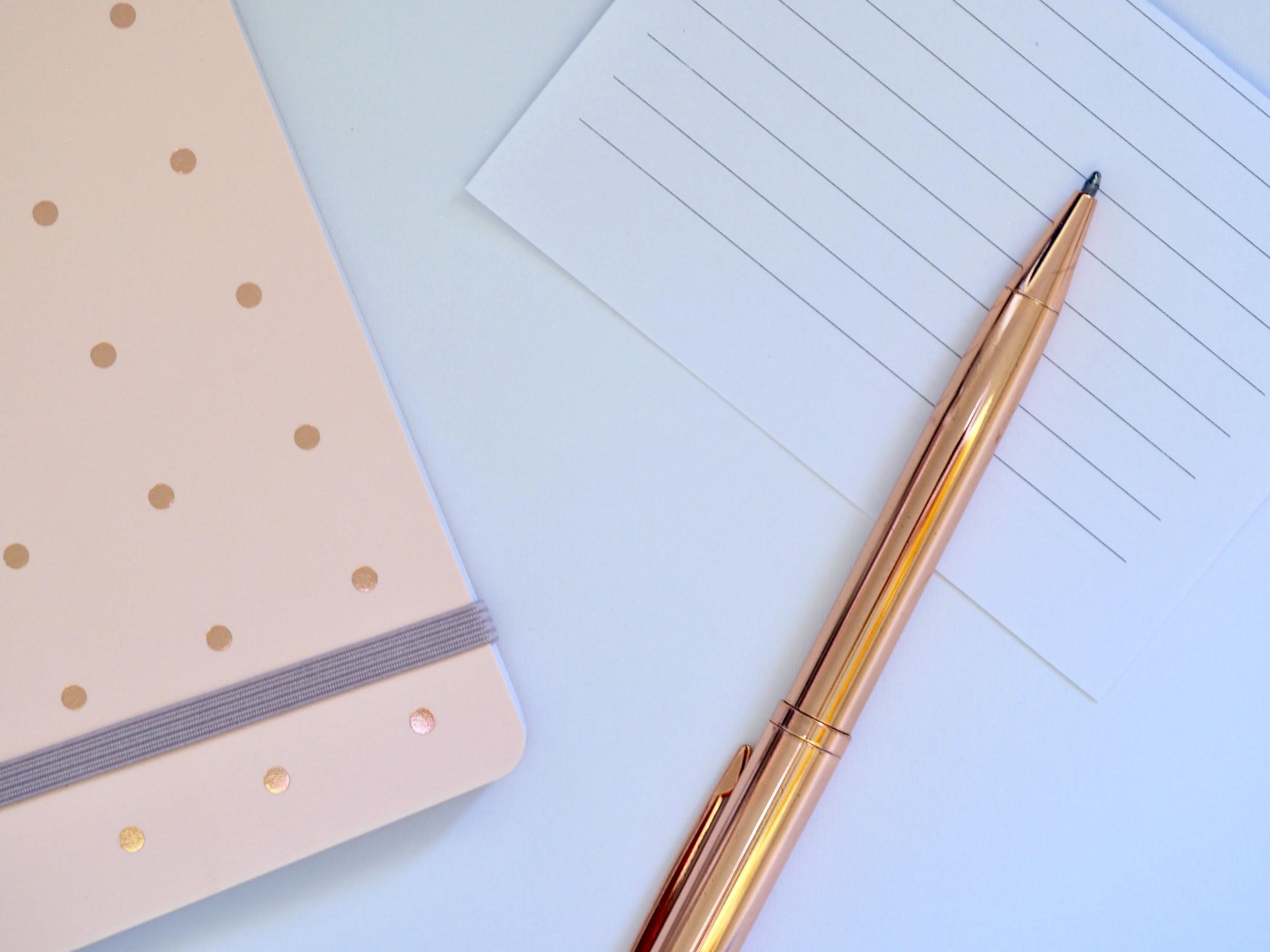 gold-pen-and-lined-paper