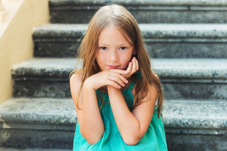 young girl on steps