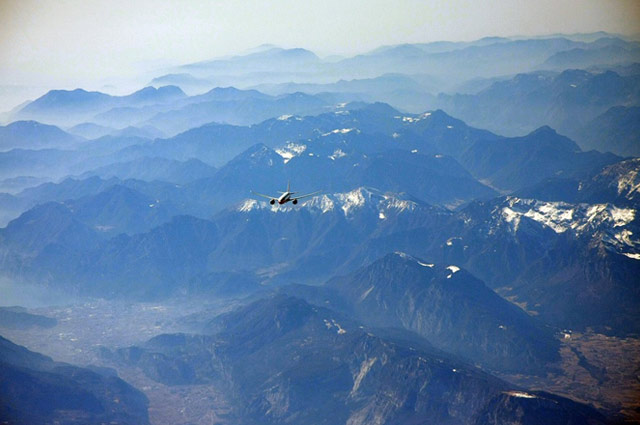 Plane flying over mountains