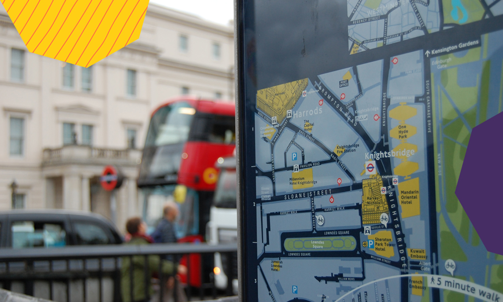 "a map of london on a bus station with a background of a red double decker in London ""A"