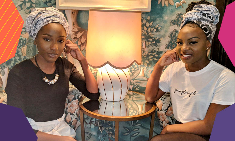"""Christiane Sungu and Lucrece Legacy sitting indoors next to each other dressed in headscarfs and black and white outfits""""A"""