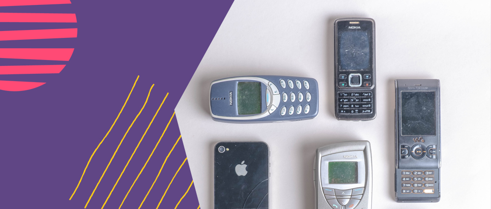 A selection of older phones like Nokia Apple 4 on a white background